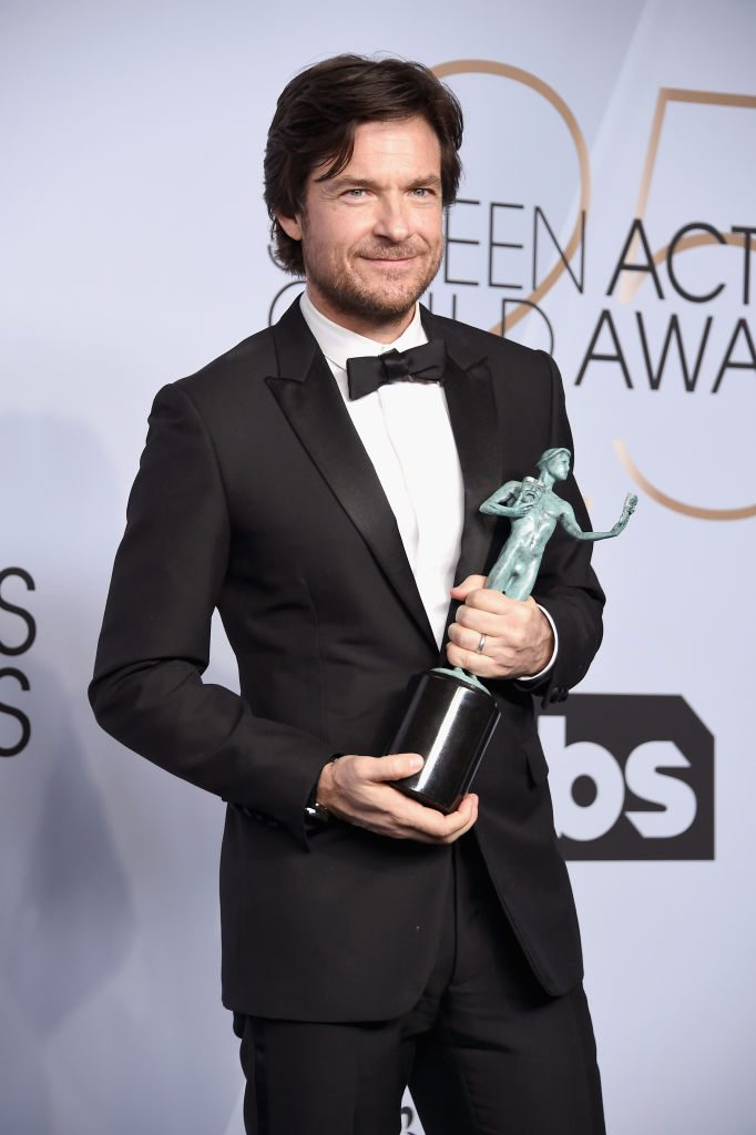 LOS ANGELES, CA - JANUARY 27:  Jason Bateman poses in the press room with award for Outstanding Performance by a Male Actor in a Drama Series in 'Ozark' during the 25th Annual Screen Actors Guild Awards at The Shrine Auditorium on January 27, 2019 in Los Angeles, California. 480645  (Photo by Gregg DeGuire/Getty Images for Turner)