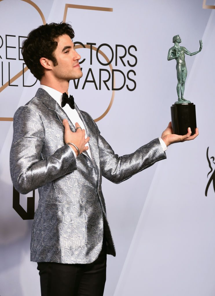 LOS ANGELES, CA - JANUARY 27:  Darren Criss poses in the press room with award for Outstanding Performance by a Male Actor in a Miniseries or Television Movie in 'The Assassination of Gianni Versace: American Crime Story' during the 25th Annual Screen Actors Guild Awards at The Shrine Auditorium on January 27, 2019 in Los Angeles, California. 480645  (Photo by Gregg DeGuire/Getty Images for Turner)