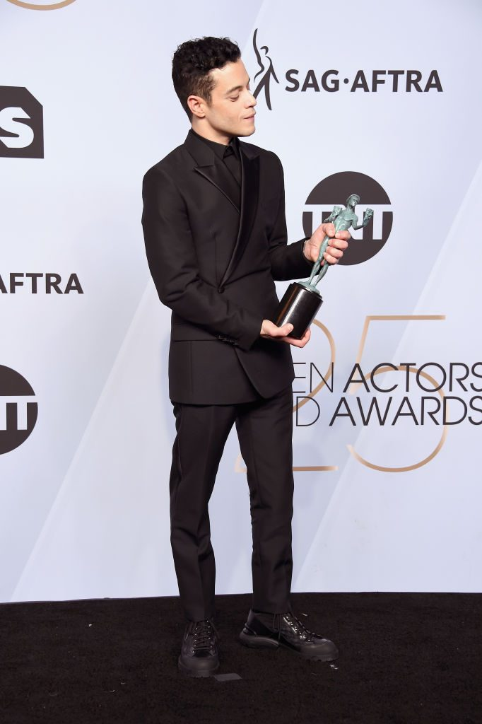 LOS ANGELES, CA - JANUARY 27:  Rami Malek poses in the press room with award for Outstanding Performance by a Male Actor in a Leading Role in 'Bohemian Rhapsody' during the 25th Annual Screen Actors Guild Awards at The Shrine Auditorium on January 27, 2019 in Los Angeles, California. 480645  (Photo by Gregg DeGuire/Getty Images for Turner)