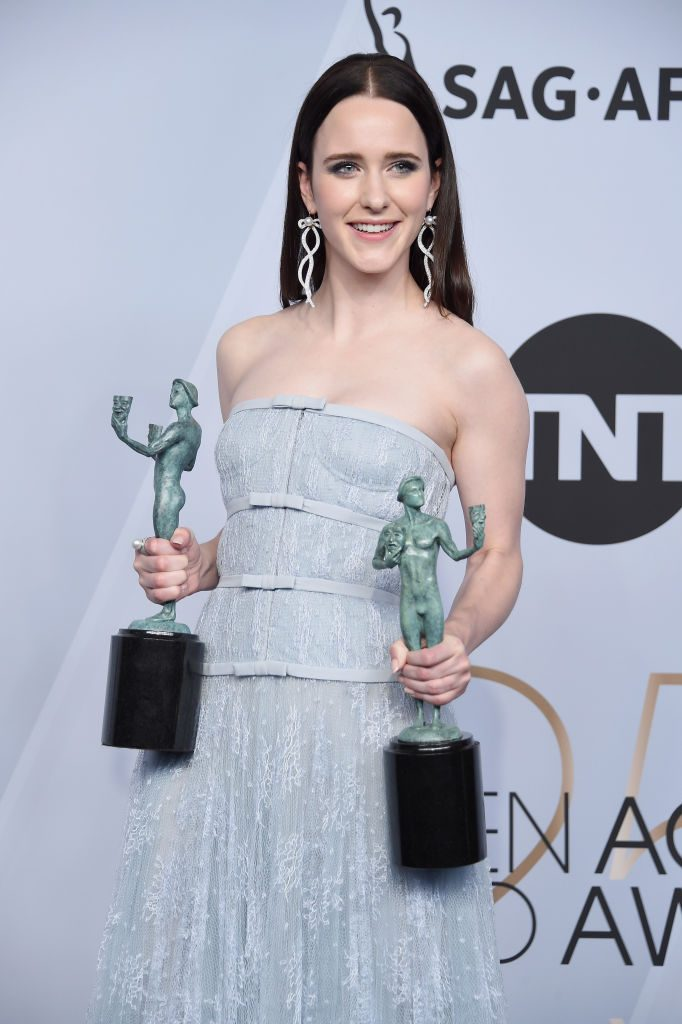 LOS ANGELES, CA - JANUARY 27:  Rachel Brosnahan poses in the press room with awards for Outstanding Performance by a Female Actor in a Comedy Series and Outstanding Performance by an Ensemble in a Comedy Series in The Marvelous Mrs. Maisel during the 25th Annual Screen Actors Guild Awards at The Shrine Auditorium on January 27, 2019 in Los Angeles, California. 480645  (Photo by Gregg DeGuire/Getty Images for Turner)
