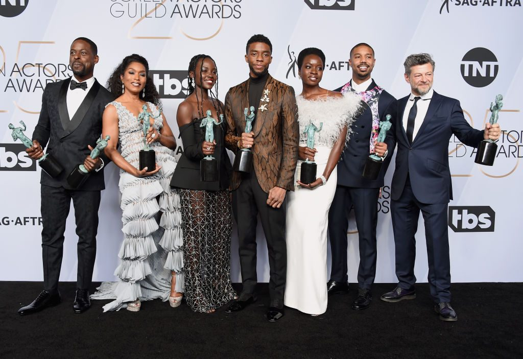 LOS ANGELES, CA - JANUARY 27:  (L-R) Sterling K. Brown, Angela Bassett, Lupita Nyong'o, Chadwick Boseman, Danai Gurira, Michael B. Jordan, and Andy Serkis pose in the press room with awards for Outstanding Performance by a Cast in a Motion Picture in 'Black Panther' during the 25th Annual Screen Actors Guild Awards at The Shrine Auditorium on January 27, 2019 in Los Angeles, California. 480645  (Photo by Gregg DeGuire/Getty Images for Turner)