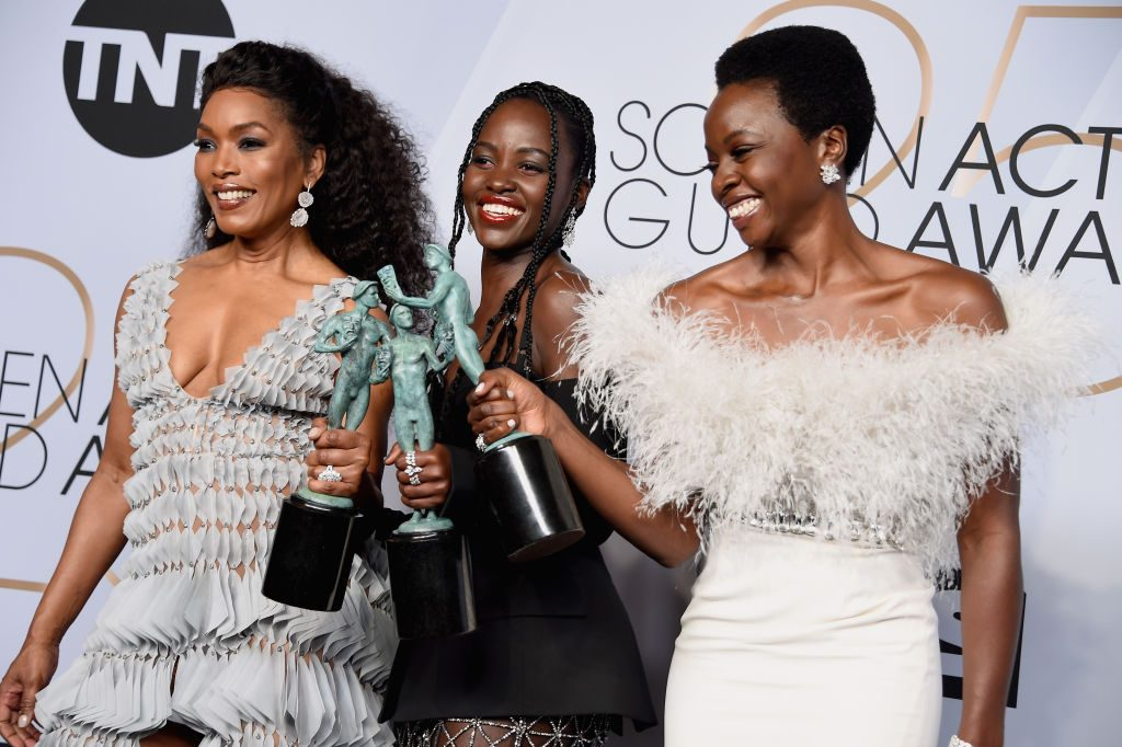 LOS ANGELES, CA - JANUARY 27:  (L-R) Angela Bassett, Lupita Nyong'o, and Danai Gurira pose in the press room during the 25th Annual Screen ActorsGuild Awards at The Shrine Auditorium on January 27, 2019 in Los Angeles, California. 480645  (Photo by Gregg DeGuire/Getty Images for Turner)