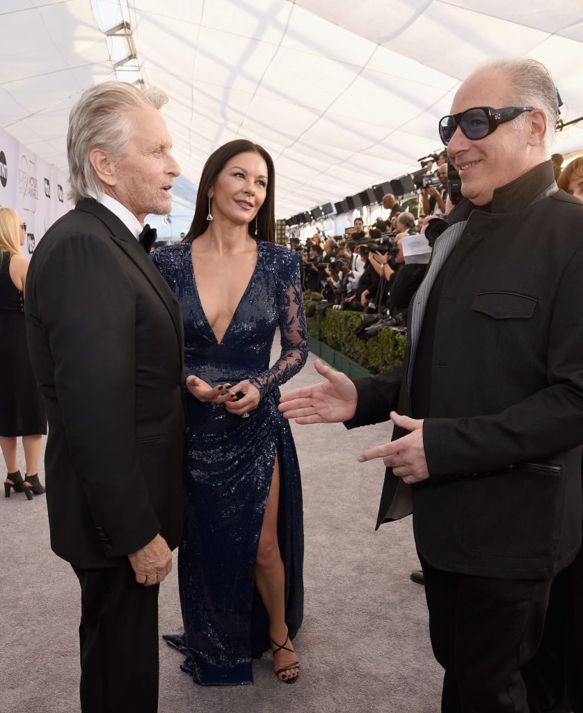 LOS ANGELES, CA - JANUARY 27: (L-R) Michael Douglas, Catherine Zeta-Jones and Andrew Dice Clay attend the 25th Annual Screen ActorsGuild Awards at The Shrine Auditorium on January 27, 2019 in Los Angeles, California.  (Photo by Presley Ann/Getty Images)
