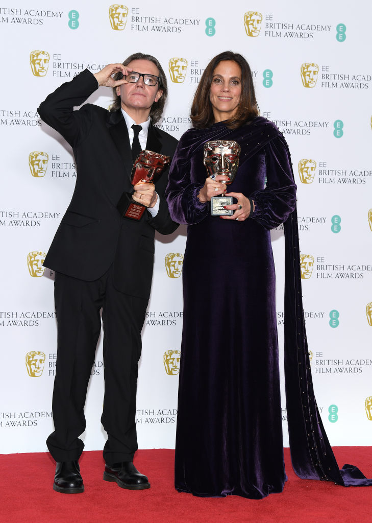 LONDON, ENGLAND - FEBRUARY 10:  Winners of the Outstanding Contribution To Cinema award, Stephen Woolley (L) and Elizabeth Karlsen pose in the press room during the EE British Academy Film Awards at Royal Albert Hall on February 10, 2019 in London, England. (Photo by Pascal Le Segretain/Getty Images)