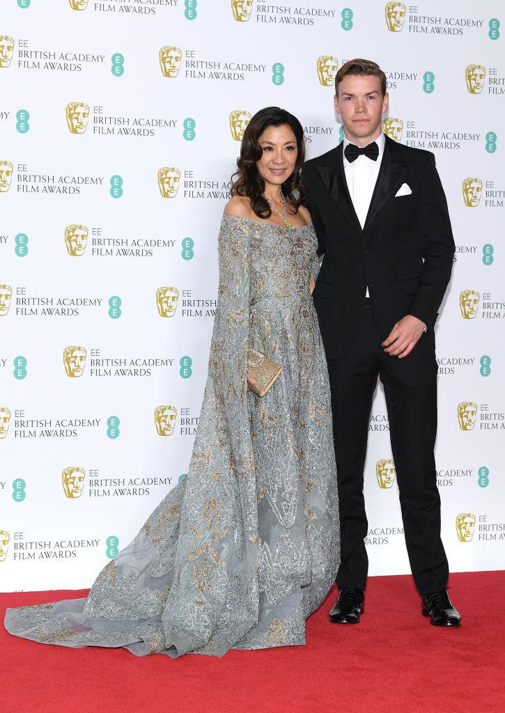 LONDON, ENGLAND - FEBRUARY 10:  Michelle Yeoh (L) and Will Poulter  pose in the press room during the EE British Academy Film Awards at Royal Albert Hall on February 10, 2019 in London, England. (Photo by Pascal Le Segretain/Getty Images)