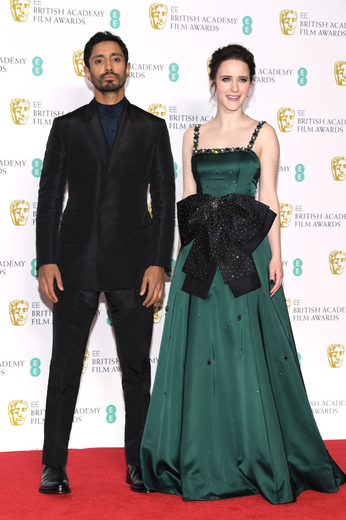 LONDON, ENGLAND - FEBRUARY 10:  Riz Ahmed (L) and Rachel Brosnahan pose in the press room during the EE British Academy Film Awards at Royal Albert Hall on February 10, 2019 in London, England. (Photo by Pascal Le Segretain/Getty Images)