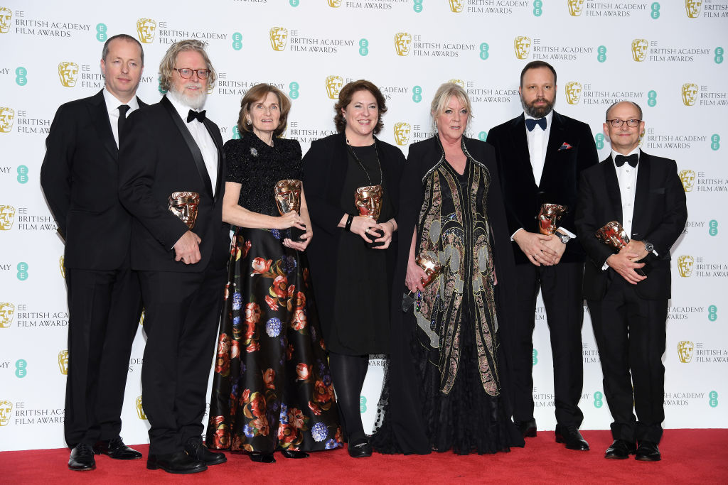 LONDON, ENGLAND - FEBRUARY 10:  (L-R) Winners of the Outstanding British Film award, Andrew Lowe, Tony McNamara, Deborah Davis, Lee Magiday, Ceci Dempsey, director Yorgos Lanthimos and Ed Guiney pose in the press room during the EE British Academy Film Awards at Royal Albert Hall on February 10, 2019 in London, England. (Photo by Pascal Le Segretain/Getty Images)