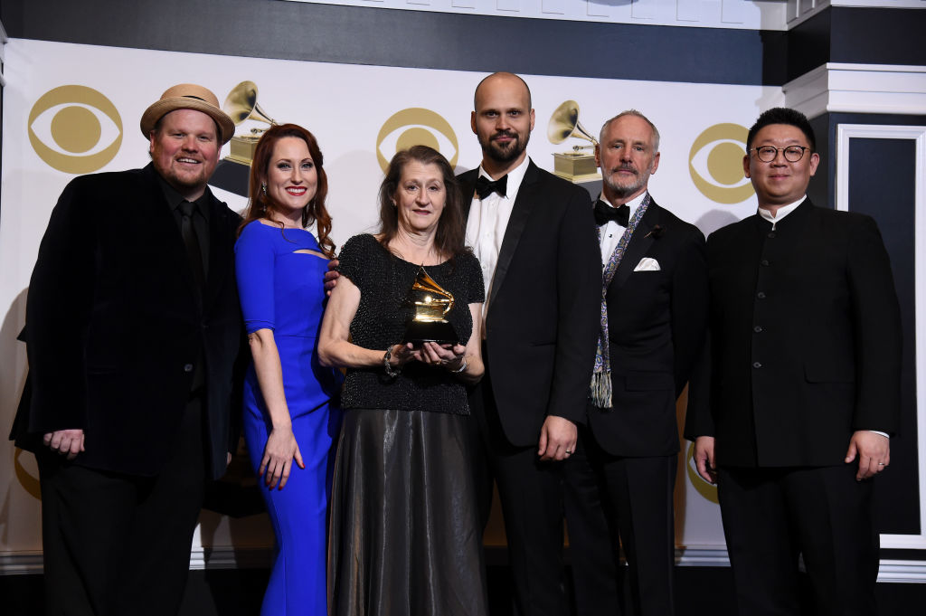 LOS ANGELES, CALIFORNIA - FEBRUARY 10: Michael Christie, Sasha Cooke, Jessica E. Jones, Edward Parks, Garrett Sorenson, Wei Wu, and Elizabeth Ostrow, winners of Best Opera Recording for 'Bates: The (R)evolution Of Steve Jobs,' pose in the press room during the 61st Annual GRAMMY Awards at Staples Center on February 10, 2019 in Los Angeles, California. (Photo by Amanda Edwards/Getty Images)