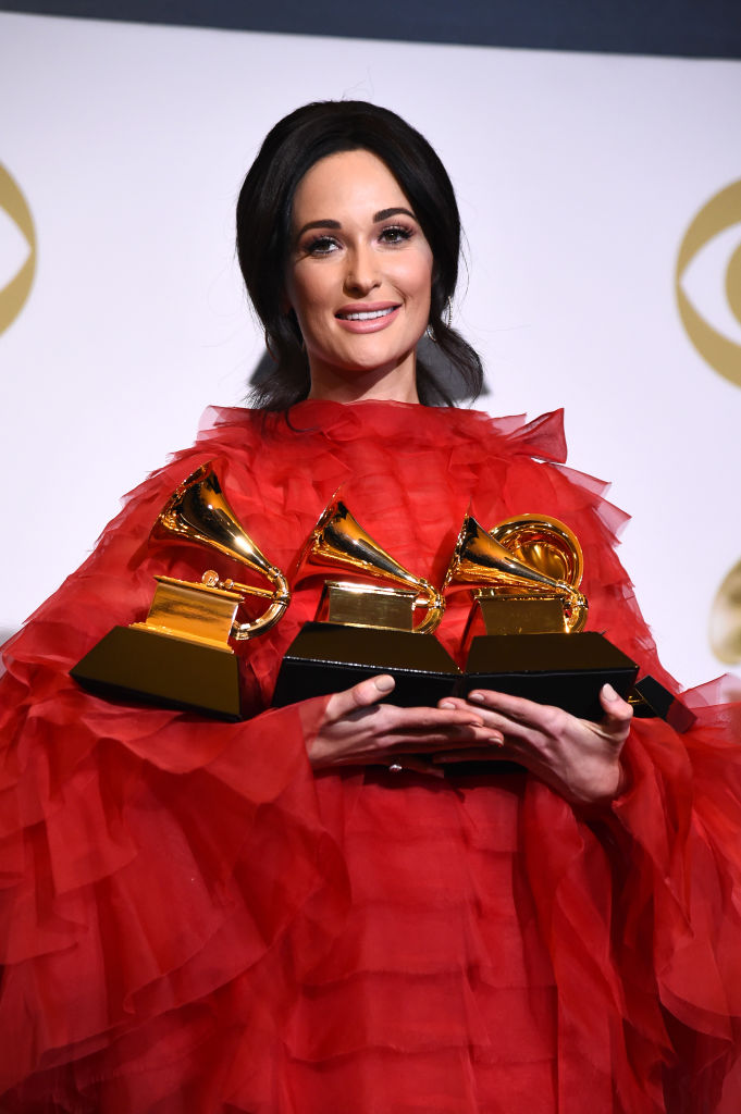 LOS ANGELES, CALIFORNIA - FEBRUARY 10: Kacey Musgraves, winner of Album of the Year, Best Country Album, Best Country Song, and Best Country Solo Performance, poses in the press room during the 61st Annual GRAMMY Awards at Staples Center on February 10, 2019 in Los Angeles, California. (Photo by Amanda Edwards/Getty Images)
