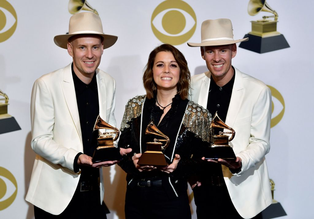 "Singer/songwriter Brandi Carlile (C), with musicians Tim and Phil Hanseroth, poses with her awards for Best American Roots Performance ""The Joke"", Best American Roots song ""The joke"" and Best Americana Album ""By the Way, I Forgive You"" in the press room during the 61st Annual Grammy Awards on February 10, 2019, in Los Angeles. (Photo by FREDERIC J. BROWN / AFP)        (Photo credit should read FREDERIC J. BROWN/AFP/Getty Images)"