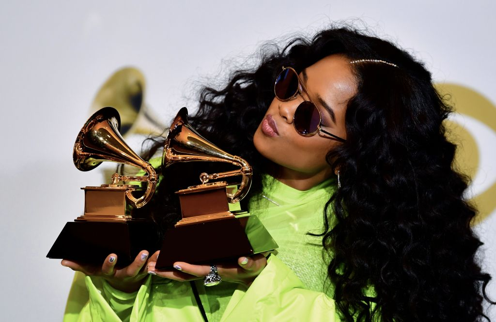 "TOPSHOT - US singer Gabriella Wilson, aka H.E.R., poses with her awards for Best R&B Performance ""Best Part"" and Best R&B Album ""H.E.R."" in the press room during the 61st Annual Grammy Awards on February 10, 2019, in Los Angeles. (Photo by Frederic J. BROWN / AFP)        (Photo credit should read FREDERIC J. BROWN/AFP/Getty Images)"