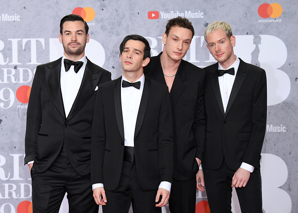 Ross MacDonald, Matthew Healy, George Daniel and Adam Hann of The 1975 attend The BRIT Awards 2019 held at The O2 Arena on February 20, 2019 in London. (Photo by: WireImage)