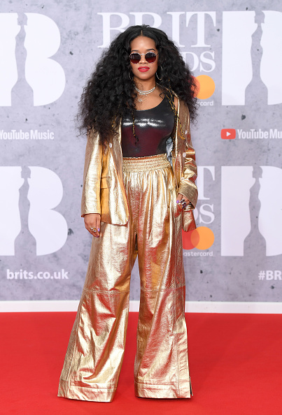 H.E.R. on the red carpet of The BRIT Awards 2019 held at The O2 Arena on February 20, 2019 in London. (Photo by: WireImage)