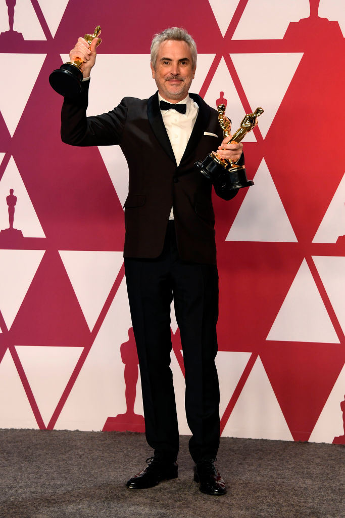 "HOLLYWOOD, CALIFORNIA - FEBRUARY 24: Alfonso Cuaron, winner of Best Foreign Language Film, Best Director and Best Cinematography for ""Roma,"" poses in the press room during the 91st Annual Academy Awards at Hollywood and Highland on February 24, 2019 in Hollywood, California. (Photo by Frazer Harrison/Getty Images)"