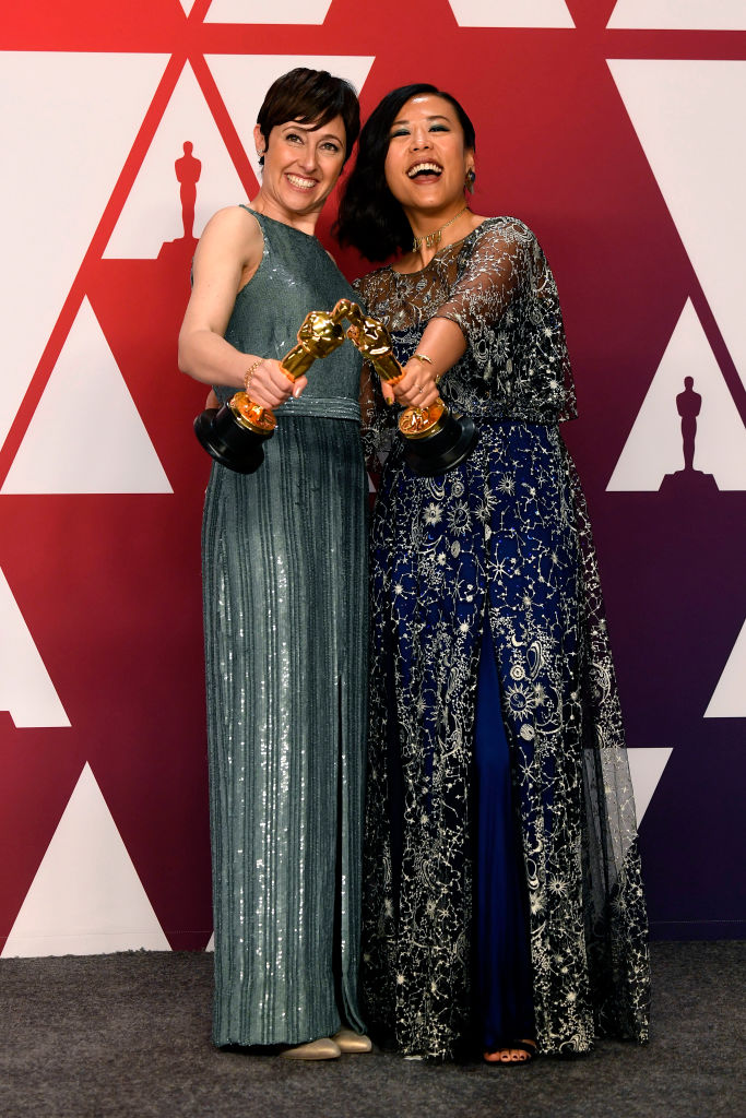 "HOLLYWOOD, CALIFORNIA - FEBRUARY 24: Becky Neiman-Cobb (L) and Domee Shi, winners of Best Animated Short Film for ""Bao,"" pose in the press room during the 91st Annual Academy Awards at Hollywood and Highland on February 24, 2019 in Hollywood, California. (Photo by Frazer Harrison/Getty Images)"