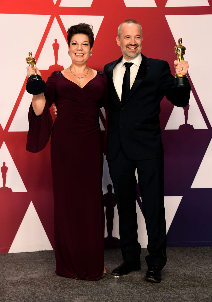 "HOLLYWOOD, CALIFORNIA - FEBRUARY 24: (L-R) Nina Hartstone and John Warhurst  pose with Best Sound Editing award for ""Bohemian Rhapsody"" in the press room during the 91st Annual Academy Awards at Hollywood and Highland on February 24, 2019 in Hollywood, California. (Photo by Frazer Harrison/Getty Images)"