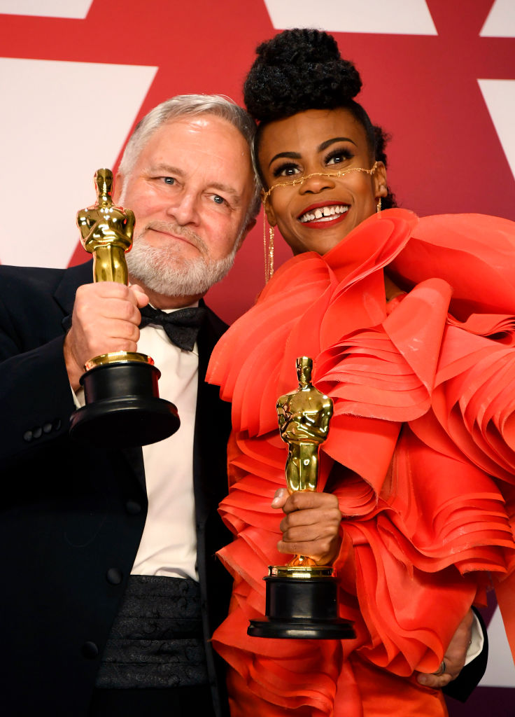 "HOLLYWOOD, CALIFORNIA - FEBRUARY 24:  (L-R) Jay R. Hart and Hannah Beachler pose with the Best Production Design award for ""Black Panther"" in the press room during the 91st Annual Academy Awards at Hollywood and Highland on February 24, 2019 in Hollywood, California. (Photo by Frazer Harrison/Getty Images)"