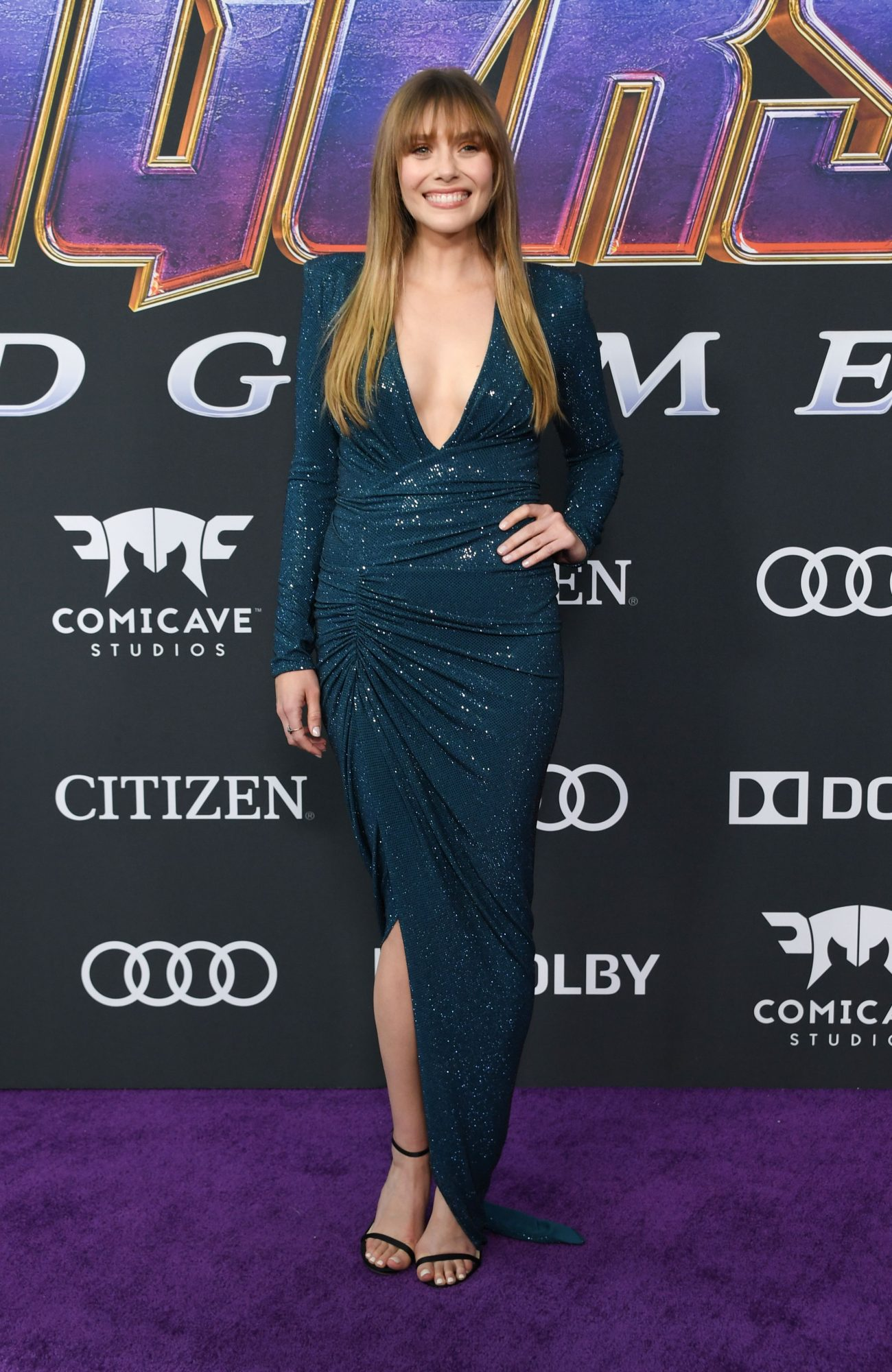 """US actress Elizabeth Olsen arrives for the World premiere of Marvel Studios' """"Avengers: Endgame"""" at the Los Angeles Convention Center on April 22, 2019 in Los Angeles. (Photo by VALERIE MACON/ AFP/ Getty Images)"""