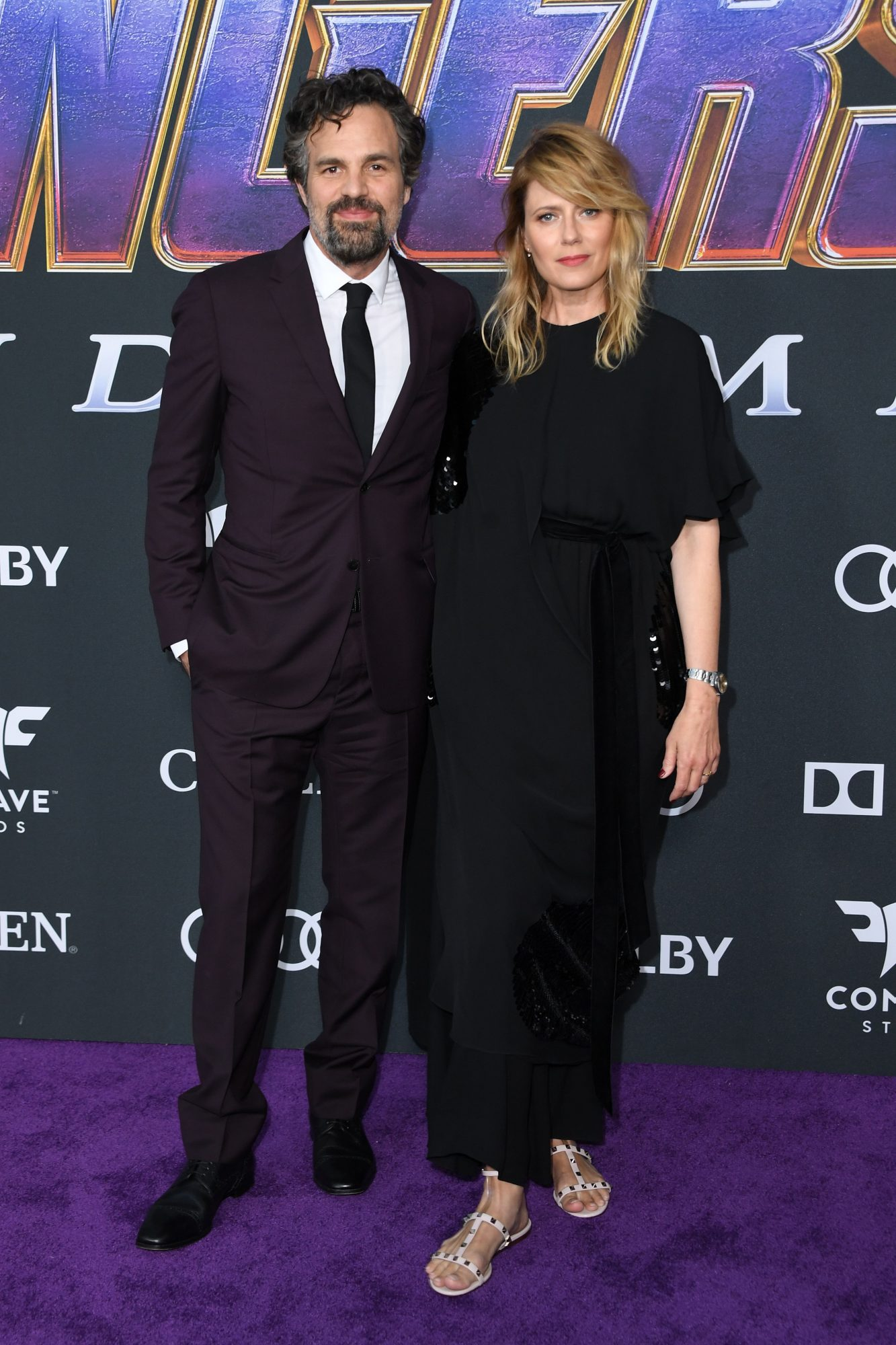 """US actor Mark Ruffalo and US actress Sunrise Coigney arrives for the World premiere of Marvel Studios' """"Avengers: Endgame"""" at the Los Angeles Convention Center on April 22, 2019 in Los Angeles. (Photo by VALERIE MACON/AFP/Getty Images)"""