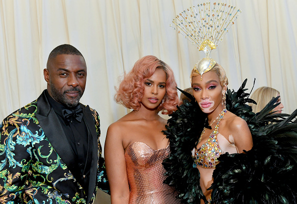 (L-R) Idris Elba, Sabrina Dhowre and Winnie Harlow attend The 2019 Met Gala Celebrating Camp: Notes on Fashion at Metropolitan Museum of Art on May 06, 2019 in New York City. (Photo by Mike Coppola/MG19/Getty Images for The Met Museum/Vogue )