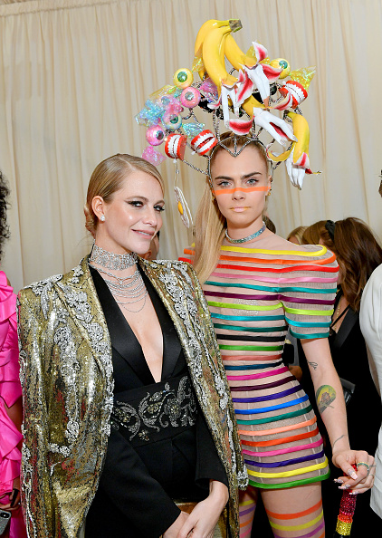 Poppy Delevingne and Cara Delevingne attend The 2019 Met Gala Celebrating Camp: Notes on Fashion at Metropolitan Museum of Art on May 06, 2019 in New York City. (Photo by Mike Coppola/MG19/Getty Images for The Met Museum/Vogue )