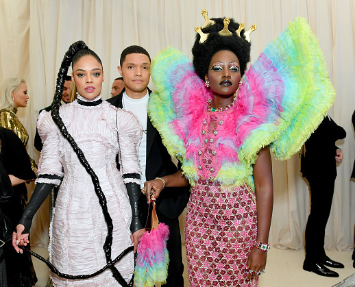 Tessa Thompson, Trevor Noah and Lupita Nyong'o attend The 2019 Met Gala Celebrating Camp: Notes on Fashion at Metropolitan Museum of Art on May 06, 2019 in New York City. (Photo by Mike Coppola/MG19/Getty Images for The Met Museum/Vogue )