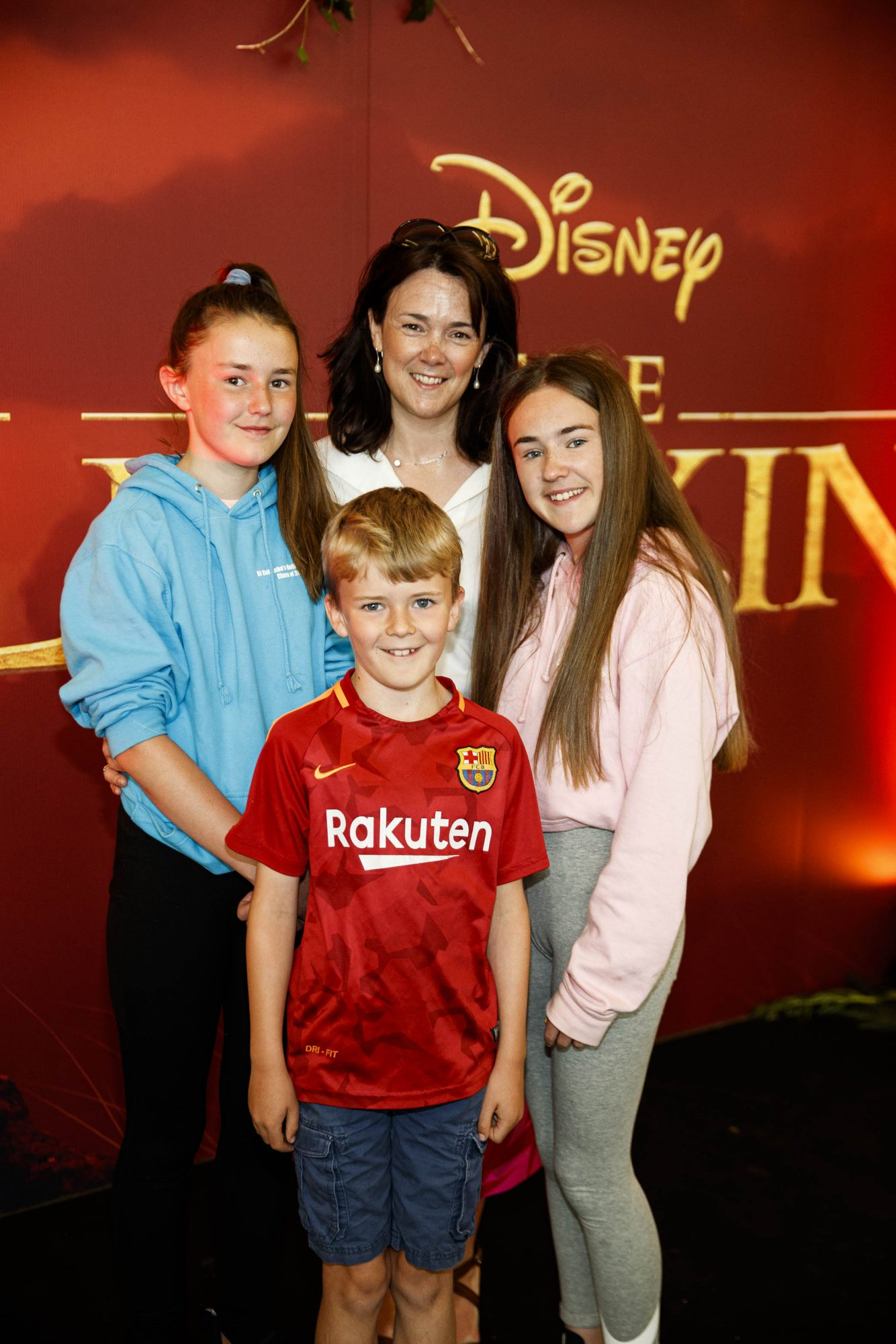 Denise Fitzgerald with children Grace (12,) Ava (14) and Eoin (9) at a special family screening of Disney's THE LION KING at the Odeon Point Village. Picture: Andres Poveda