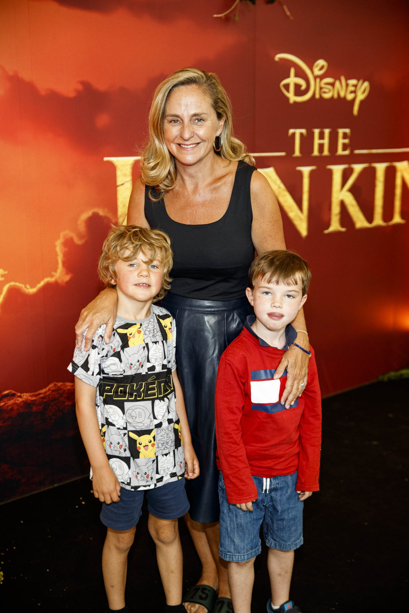 Debbie O'Donnell pictured with Sam Carroll (6) and Henry Cox (6) at a special family screening of Disney's THE LION KING at the Odeon Point Village. Picture: Andres Poveda