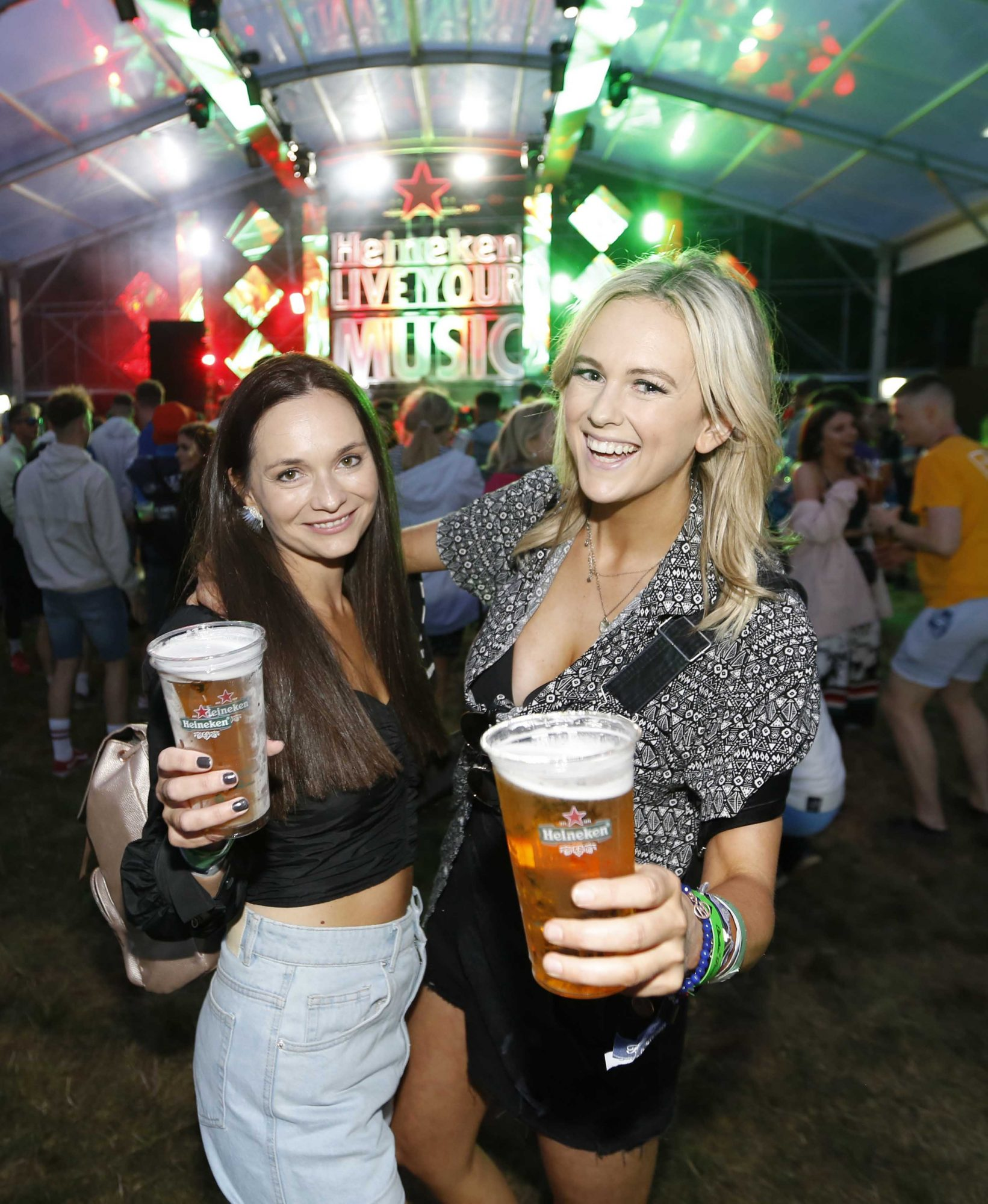NO REPRO FEE 30/08/2019 Heineken Live Your Music Stage at Electric Picnic 2019. Pictured are (LtoR) Linda May- Fox and Cassie Stokes at the Heineken Live Your Music Stage at Electric Picnic 2019. This year's area is an enormous structure on two levels, with a glass roof that will keep festival-goers dry but let them dance beneath the sun and stars! The immersive and interactive lightshow has been reimagined for 2019 which, combined with the state-of-the-art soundsystem, make Live Your Music the most impressive festival stage in the country. Photo: Sasko Lazarov/Phorocall Ireland