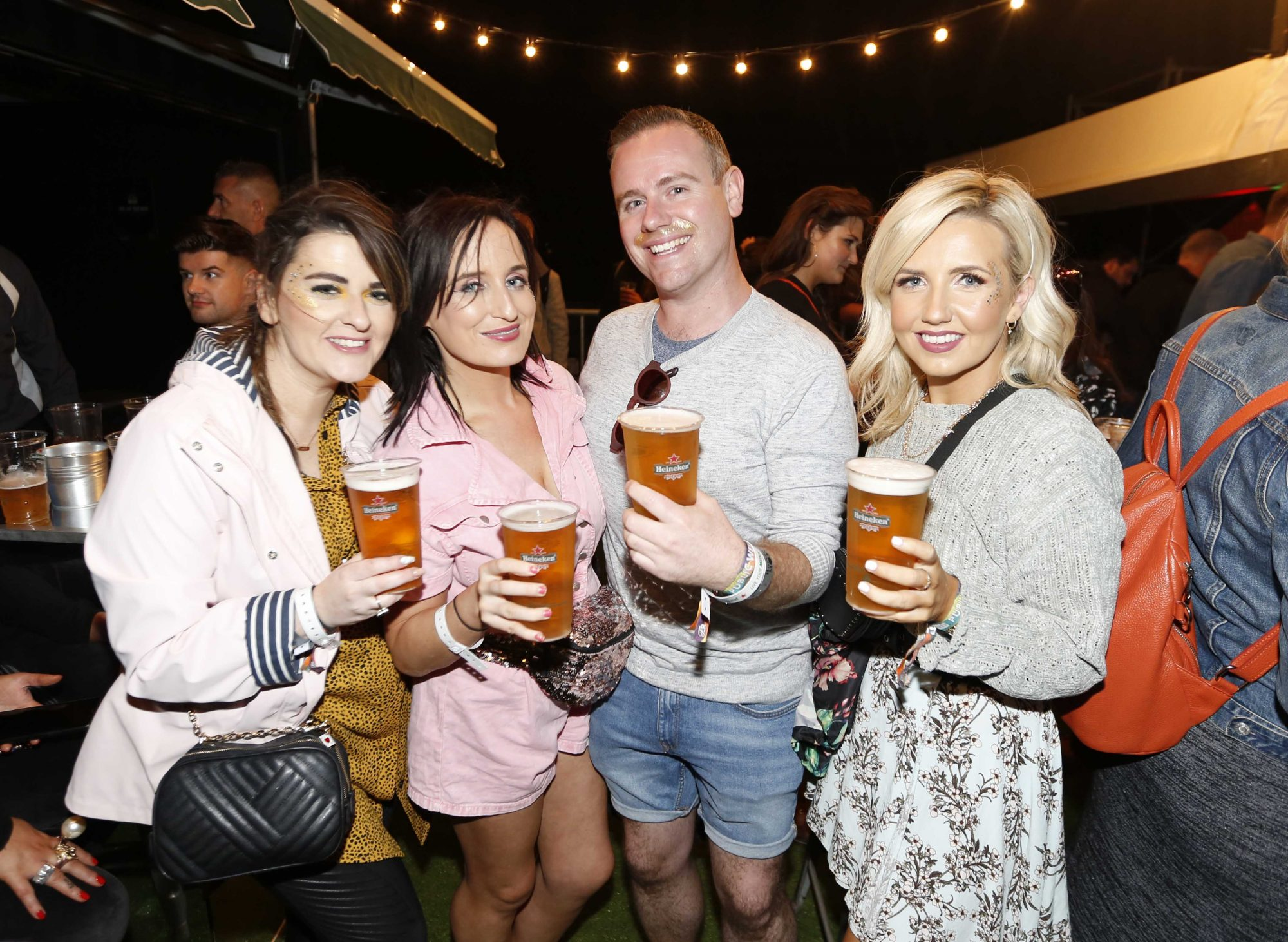 NO REPRO FEE 30/08/2019 Heineken Live Your Music Stage at Electric Picnic 2019. Pictured are (LtoR) Roisin Cummings, Nicola Barron, Neil Byrne and Tamara Matthews at the Heineken Live Your Music Stage at Electric Picnic 2019. This year's area is an enormous structure on two levels, with a glass roof that will keep festival-goers dry but let them dance beneath the sun and stars! The immersive and interactive lightshow has been reimagined for 2019 which, combined with the state-of-the-art soundsystem, make Live Your Music the most impressive festival stage in the country. Photo: Sasko Lazarov/Phorocall Ireland