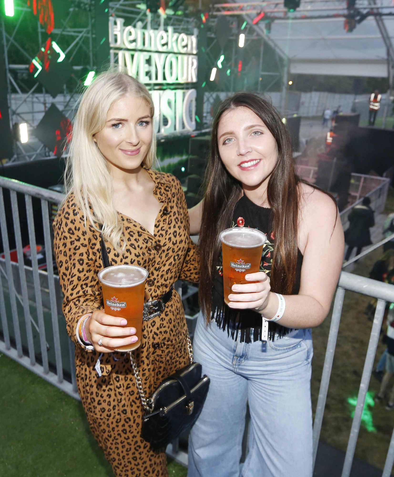 NO REPRO FEE 30/08/2019 Heineken Live Your Music Stage at Electric Picnic 2019. Pictured are (LtoR) Hannah Murphy and Fiona Hughes at the Heineken Live Your Music Stage at Electric Picnic 2019. This year's area is an enormous structure on two levels, with a glass roof that will keep festival-goers dry but let them dance beneath the sun and stars! The immersive and interactive lightshow has been reimagined for 2019 which, combined with the state-of-the-art soundsystem, make Live Your Music the most impressive festival stage in the country. Photo: Sasko Lazarov/Phorocall Ireland