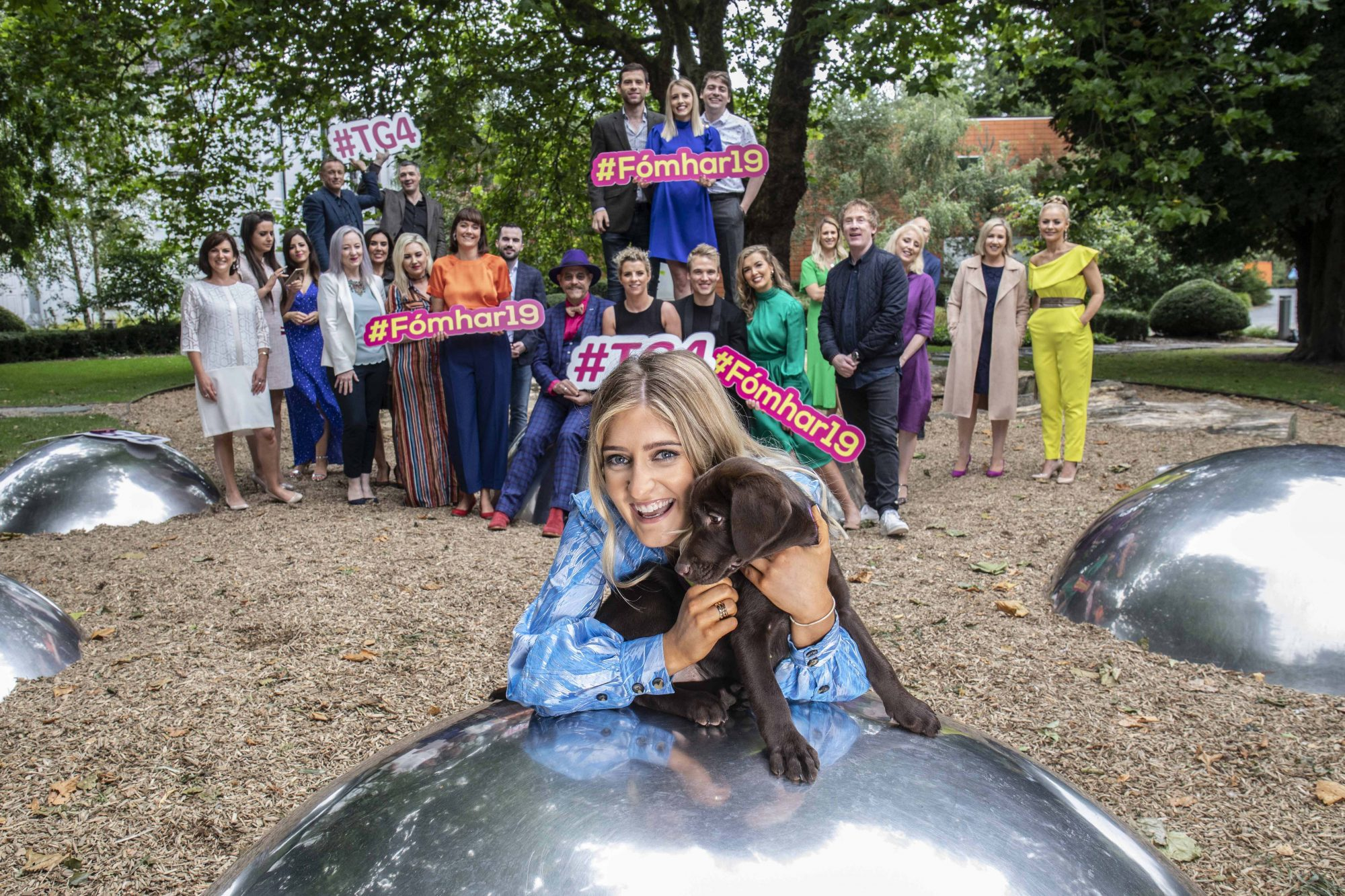 Doireann Ní Ghlacáin with puppies from Dogs for the Disabled. pictured at TG4's Autumn Schedule Launch in the stunning Fitzgerald Park in Cork.  Picture Clare Keogh