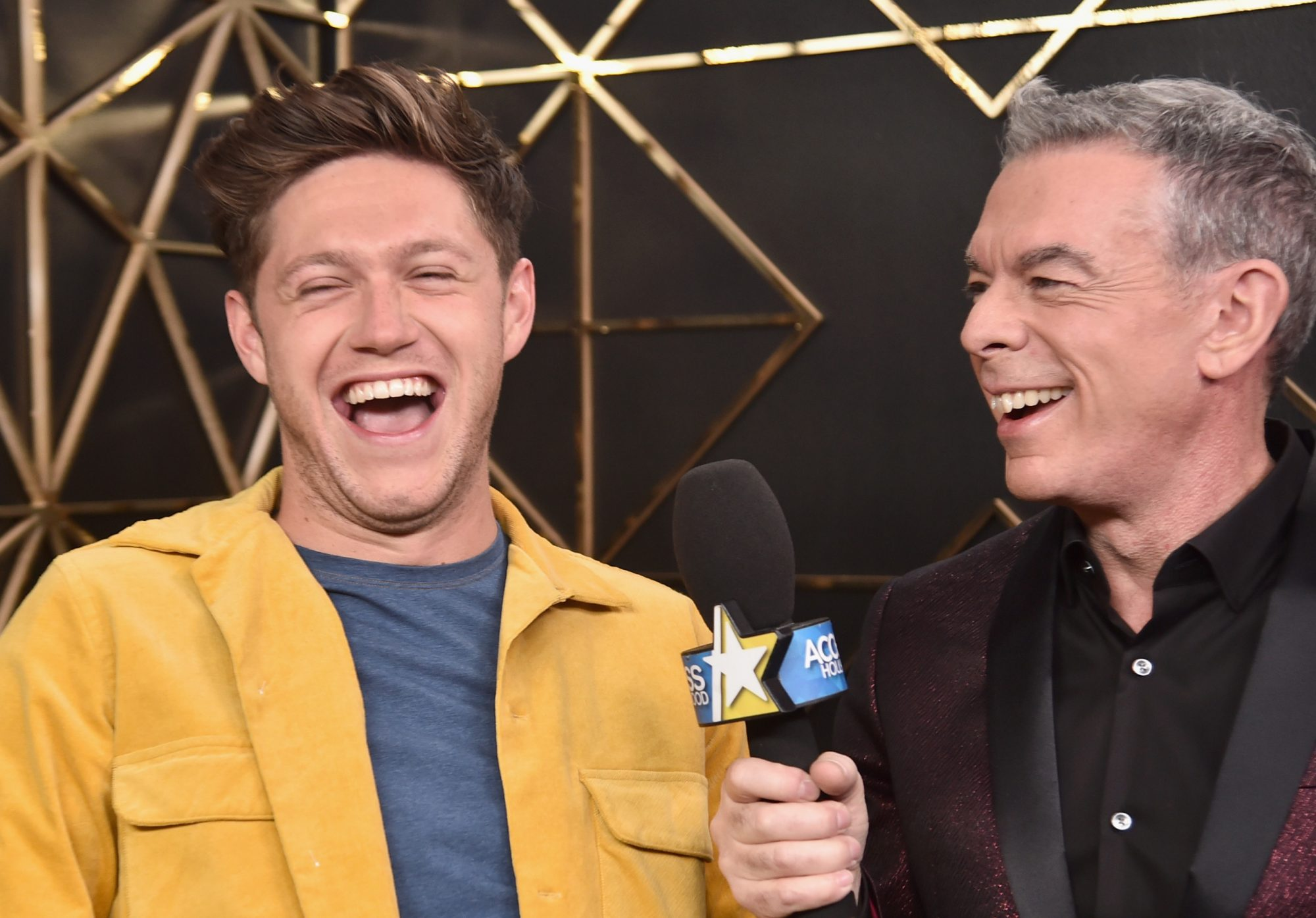 INGLEWOOD, CA - DECEMBER 01:  (EDITORIAL USE ONLY. NO COMMERCIAL USE) Niall Horan (L) and Elvis Duran in the press room during 102.7 KIIS FM's Jingle Ball 2017 presented by Capital One at The Forum on December 1, 2017 in Inglewood, California.  (Photo by Alberto E. Rodriguez/Getty Images for iHeartMedia)
