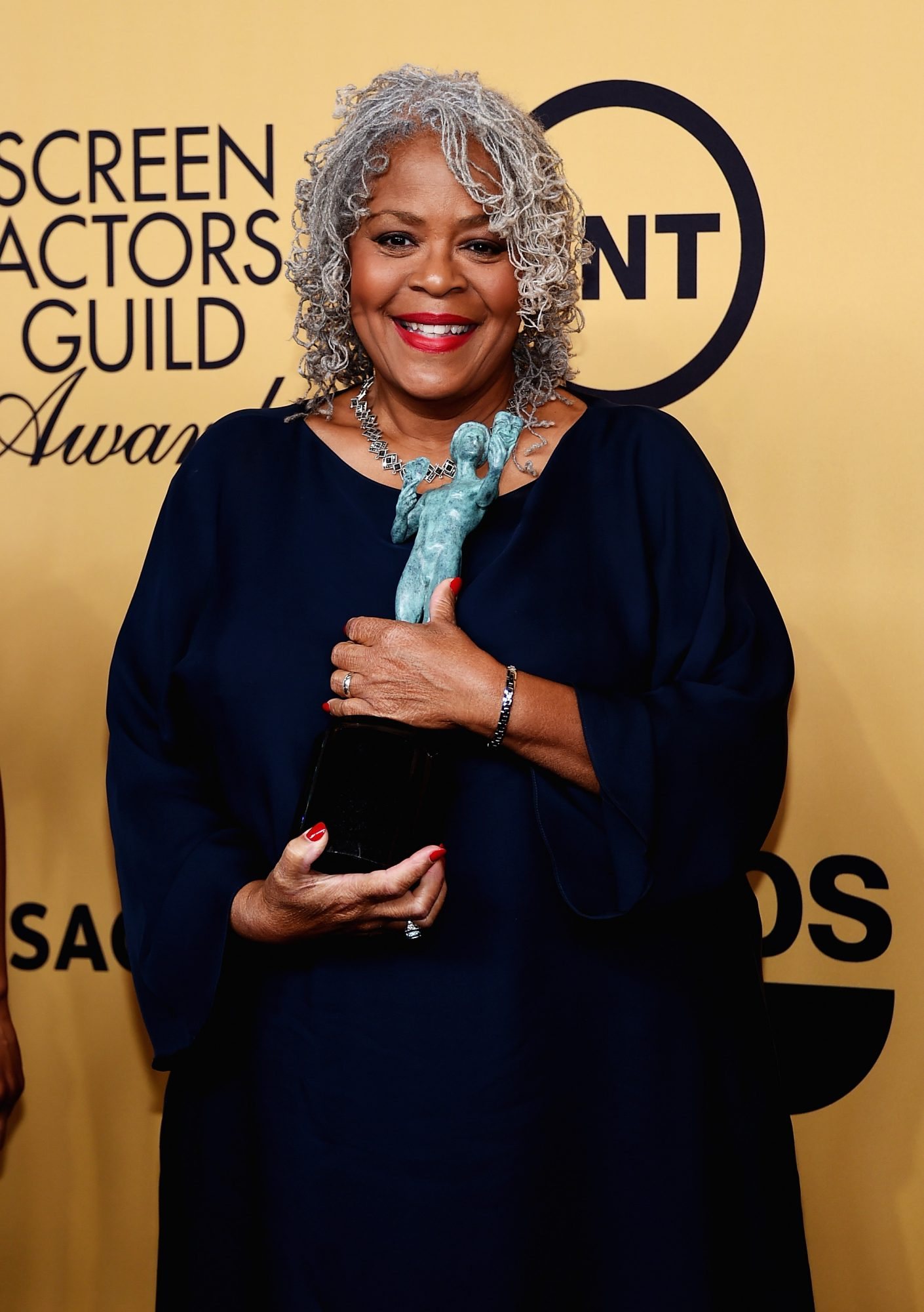 LOS ANGELES, CA - JANUARY 25:  Actress Yvette Freeman, winner of Outstanding Performance by an Ensemble in a Comedy Series for 'Orange Is the New Black,' poses in the press room at the 21st Annual Screen Actors Guild Awards at The Shrine Auditorium on January 25, 2015 in Los Angeles, California.  (Photo by Ethan Miller/Getty Images)