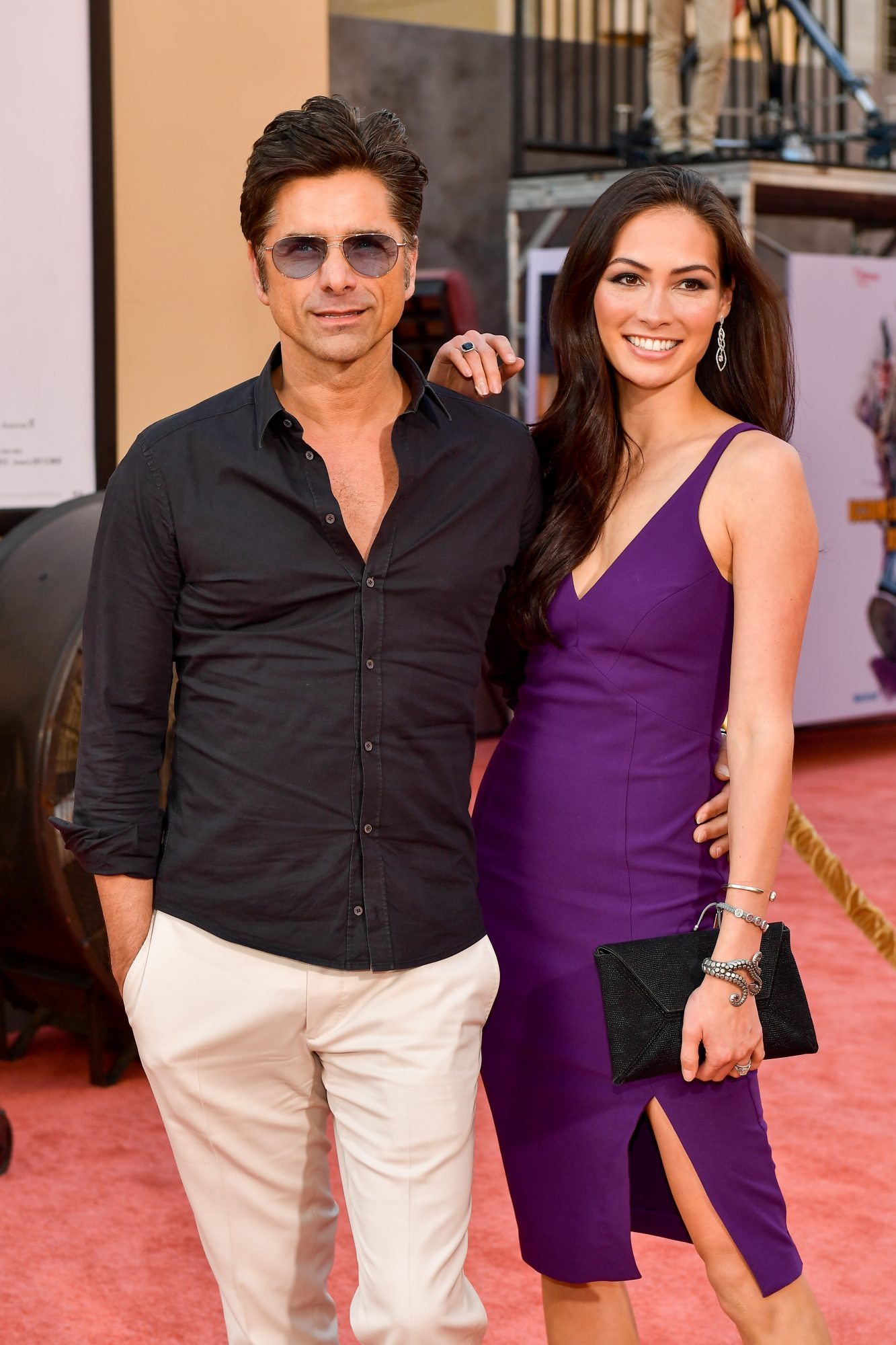 """HOLLYWOOD, CALIFORNIA - JULY 22: John Stamos and Caitlin McHugh attends Sony Pictures' """"Once Upon A Time...In Hollywood"""" Los Angeles Premier on July 22, 2019 in Hollywood, California. (Photo by Matt Winkelmeyer/Getty Images)"""