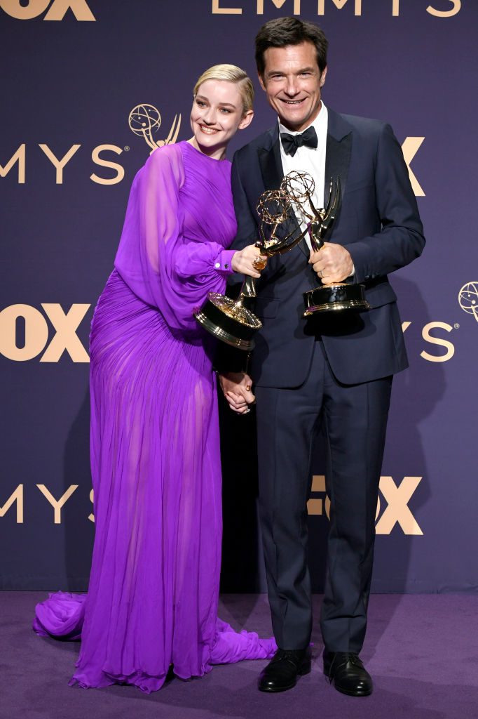 (L-R) Julia Garner, winner of the Outstanding Supporting Actress in a Drama Series award for 'Ozark,' and Jason Bateman, winner of the Outstanding Directing for a Drama Series award for 'Ozark,' pose in the press room during the 71st Emmy Awards at Microsoft Theater on September 22, 2019 in Los Angeles, California. (Photo by Frazer Harrison/Getty Images)