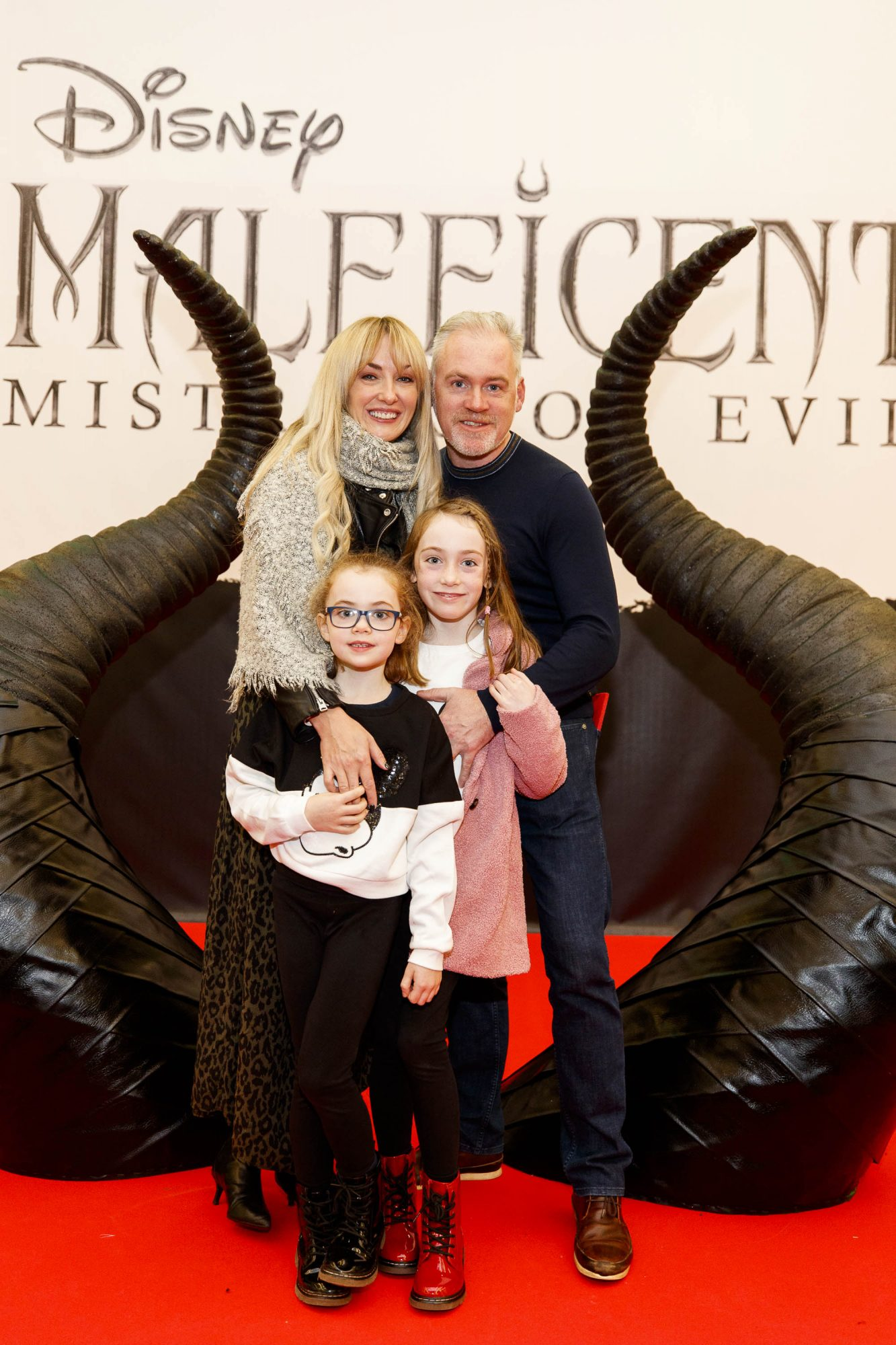 Kim McKenzie-Doyle, Fergal Doyle, Bebhinn (6) and Blaire (9) pictured at the special family preview screening of Disney's MALEFICENT: MISTRESS OF EVIL, in the Odeon Point Village. Picture Andres Poveda
