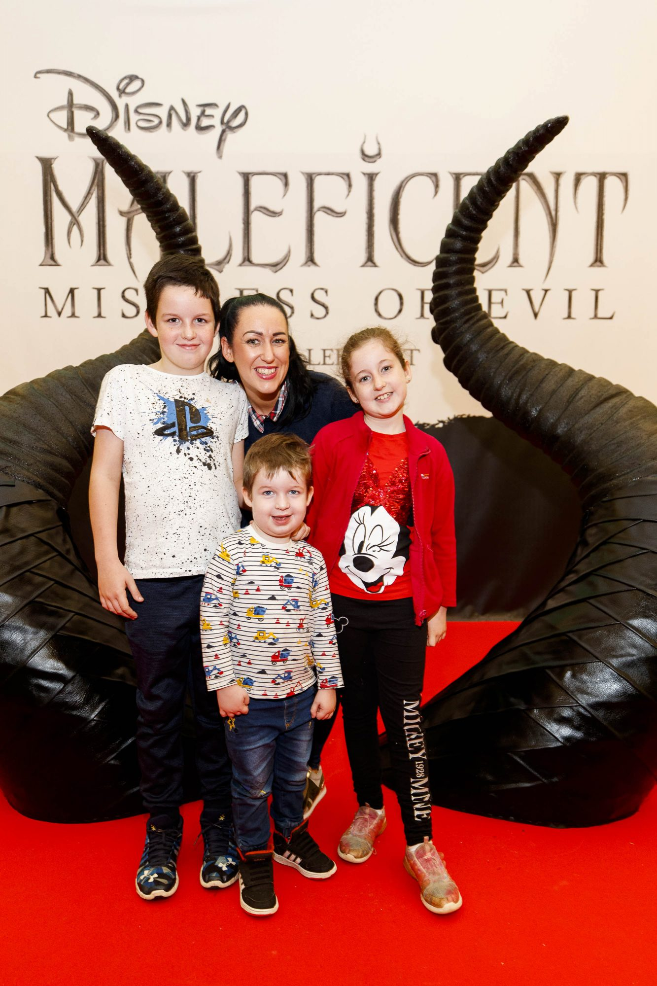 Lorna Quinn with Josh (11) Harry (3) and Ella (8) pictured at the special family preview screening of Disney's MALEFICENT: MISTRESS OF EVIL, in the Odeon Point Village. Picture Andres Poveda