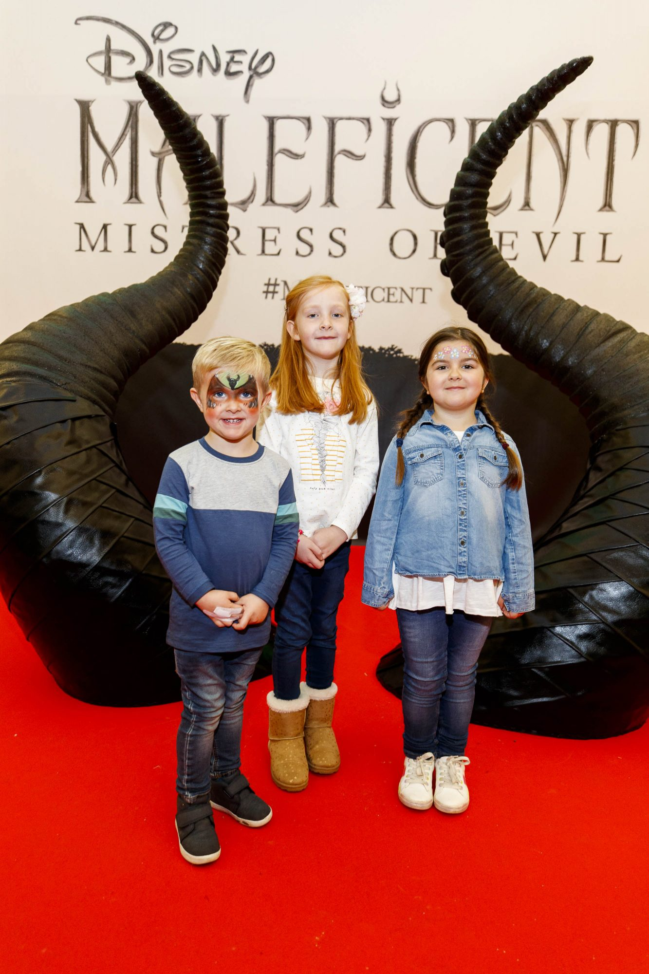 Lee (3) and Mia Eccles (5) with Sophie Vilan (6) pictured at the special family preview screening of Disney's MALEFICENT: MISTRESS OF EVIL, in the Odeon Point Village. Picture Andres Poveda