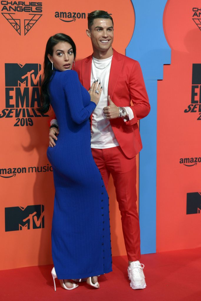 Juventus' Portuguese forward Cristiano Ronaldo (R) and his wife Georgina Rodriguez pose on the red carpet upon their arrival to the MTV Europe Music Awards at the FIBES Conference and Exhibition Centre of Seville on November 3, 2019. (Photo by CRISTINA QUICLER/AFP via Getty Images)