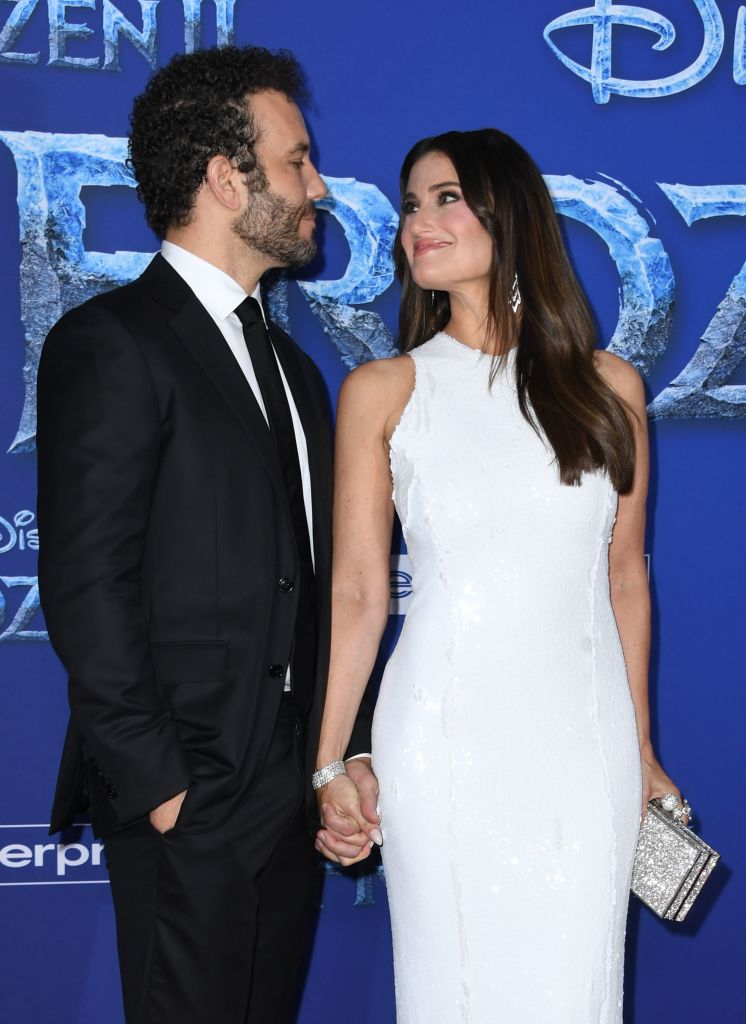 "US actress/singer Idina Menzel and her husband actor Aaron Lohr arrive for Disney's World Premiere of ""Frozen 2"" at the Dolby theatre in Hollywood on November 7, 2019. (Photo by VALERIE MACON/AFP via Getty Images)"