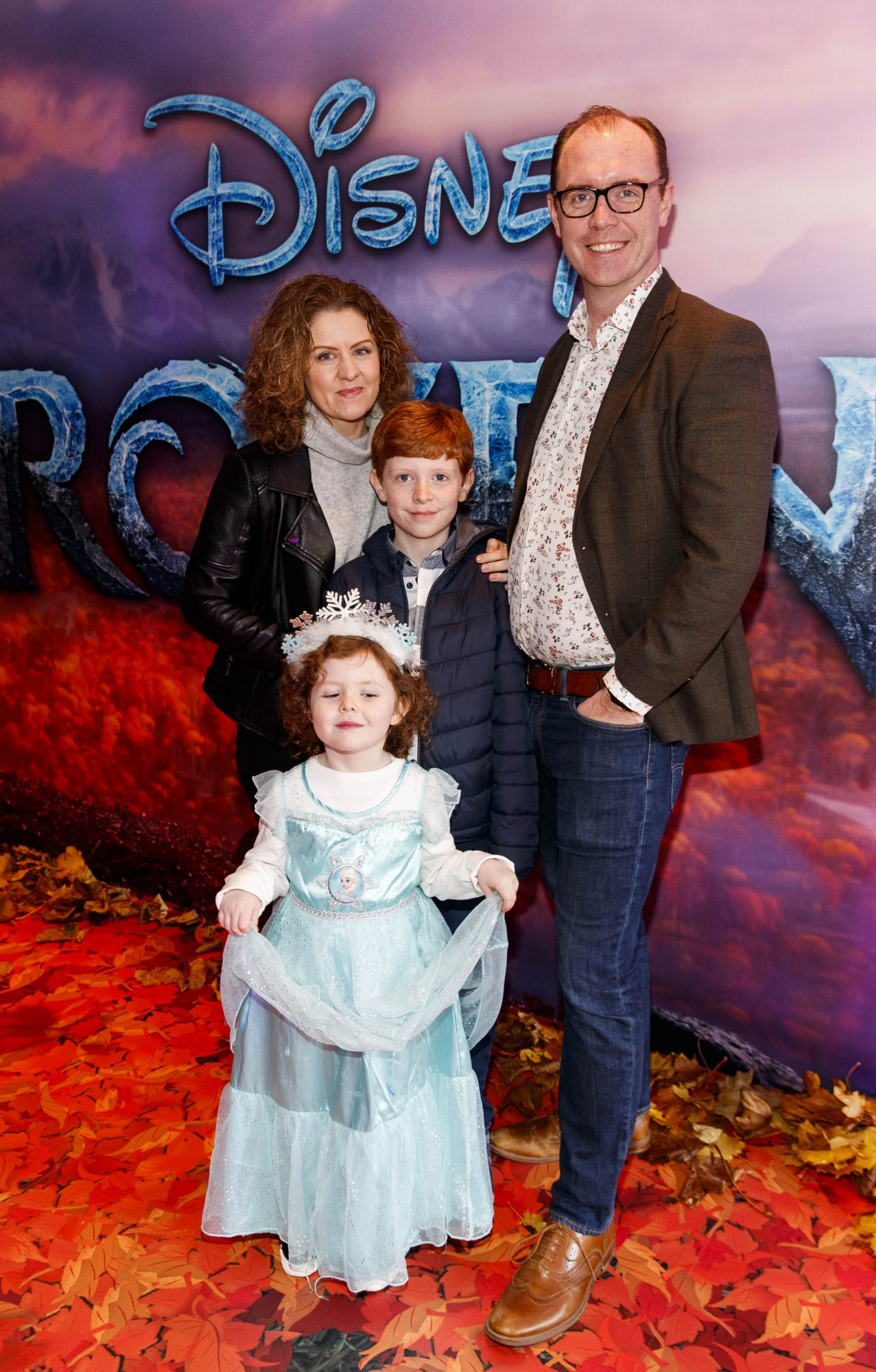 """Brian Redmond with wife Jen Anna (4) and Alex (10) pictured at the special preview screening of Disney's """"Frozen 2"""" at the Light House Cinema, Dublin.  Picture Andres Poveda"""