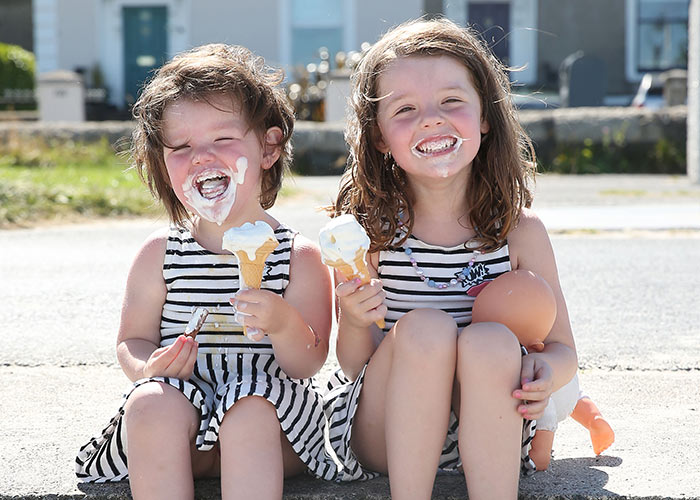 Sofia and Leah Marnane cool down with an ice cream on Sandymount strand. Pic: Fran Veale