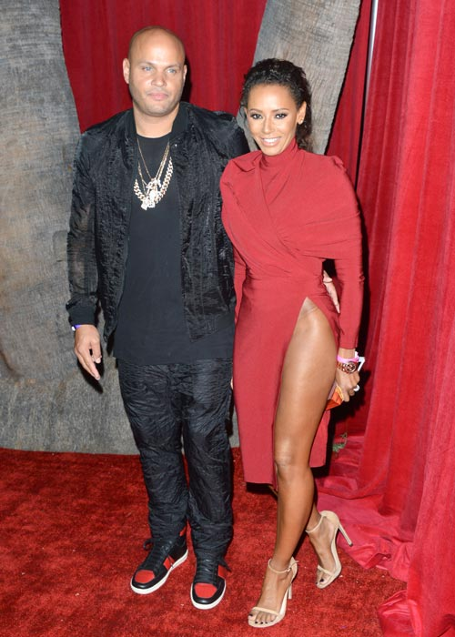 Mel B puts on a VERY leggy display in daring red dress at