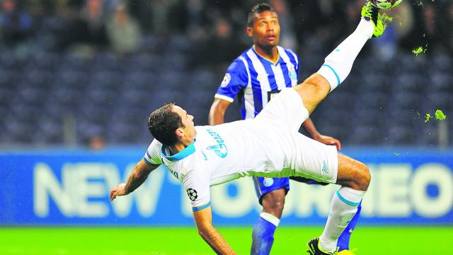 Oct. 22, 2013 - O Porto, Portugal - Russian midfield ROMAN  SHIROKOV, attempts a bicycle kick while being observed by Porto s defender during the match between F.C Porto vs F.C Zenit at Dragao Stadium. (Credit Image: © Marcio Machado/ZUMAPRESS.com)