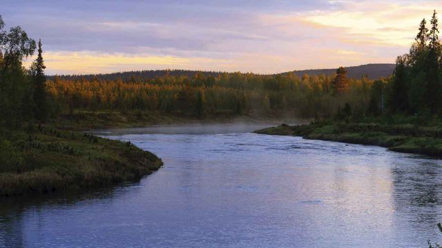 Steaming river on a very bright night in Finnish Lapland.