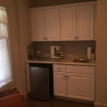 Kitchenette with refrigerator, sink and microwave