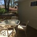 Sunny outdoor deck with table and chairs