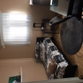 Bedroom #1, twin bed, hutch, desk with chair and lamp, nightstand with lamp, ceiling fan, closet organizer, and power bars.