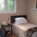 Bedroom #2, twin bed, dresser, desk with chair and lamp, nightstand with lamp, closet organizer, power bars.